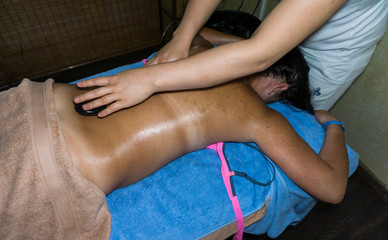 masseur doing massage on woman body in the spa salon. spa treatm