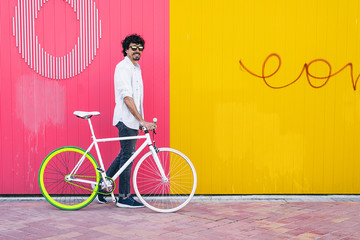 Handsome young man with fixed gear bicycle.