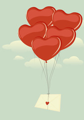 Love letter tied to a heart-shaped balloons