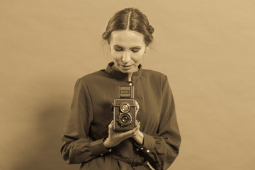 Woman taking picture with old camera