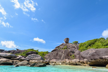 Beautiful landscape people on rock is a symbol of Similan Islands, blue sky and cloud over the sea during summer at Mu Ko Similan National Park, Phang Nga province, Thailand