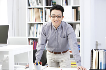 Happy young businessman at work