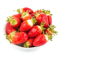 Plateful of freshly harvested organic strawberries with white background