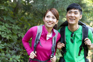Young people go hiking in mountain