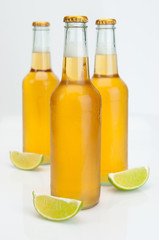 Cerveza Beer Bottles With Limes On White Background Closeup