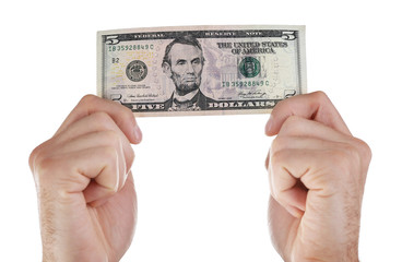 Hands holding five dollar banknote, isolated on white