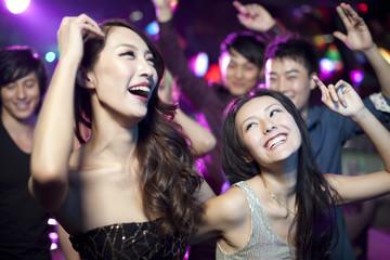 Stylish young people dancing in nightclub