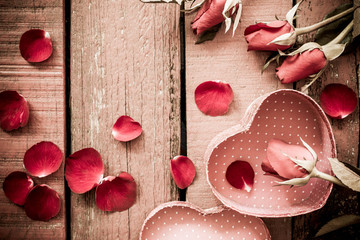 Roses and a hearts on wooden board, Valentines Day background.