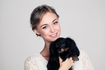 Cute Woman with Dog in Her Hands
