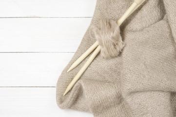 Woolen knitting on wood