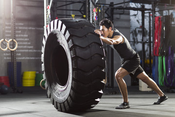 Man exercising with tractor tire