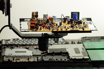 Radio components on rotation electronic board at electronics factory
