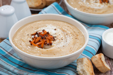 vegetable cream soup with caramelized carrots, closeup