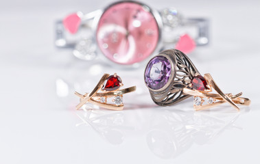 Gold earrings with rubies and elegant women's watches