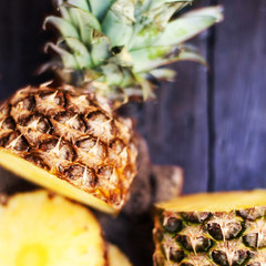 Pineapple tropical fruit or ananas with circle slices over woode