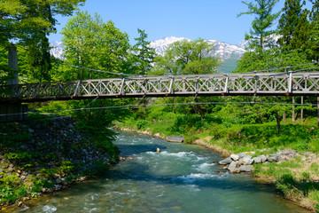Shirouma mountains and Himekawa river at Ooide park in Hakuba, Nagano, Japan