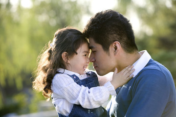 Father and daughter rubbing noses