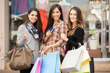 Happy women shopping together at a mall