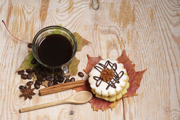 Cake, coffee and autumn leaves