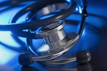 metal stethoscope on table