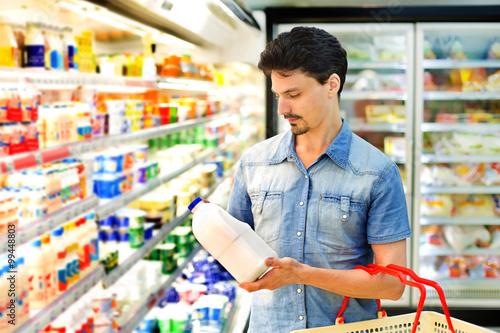 Resultado de imagem para man supermarket milk