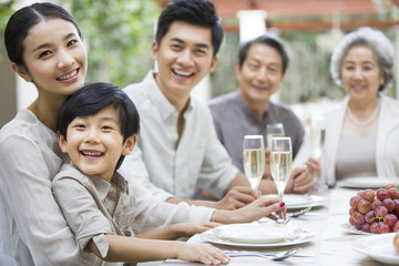 Portrait of multigenerational family at dining table