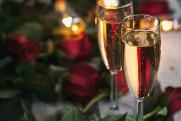 Valentine: Two Glasses Of Champagne With Roses Behind