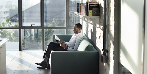 Businessman Reading Magazine Relaxation Concept