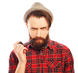 Bearded man smoking a pipe