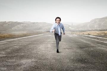 Businessman run on road