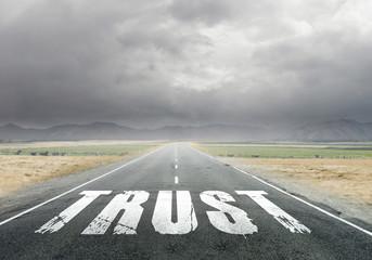 Trust word on asphalt road