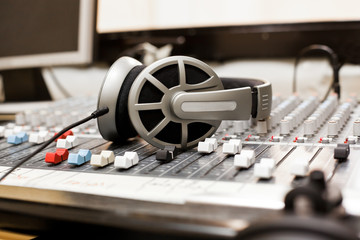 Headphones lying on the mixing console
