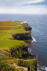 Wall Mural - Lighthouse on the cliffs of Neist Point, a famous landmark near Glendale, Isle of Skye, Scotland