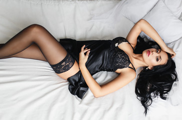 Sexy girl in a black lingerie and  stockings Wall mural