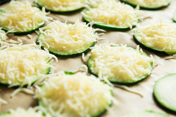 Zucchini slices with grated cheese ready to bake