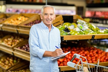 Smiling senior man with shopping list