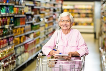 Smiling senior woman with grocery list