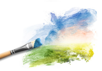 Painting the spring landscape. Brush with blue paint over sky and green field