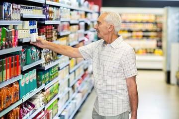 Senior man picking canned food