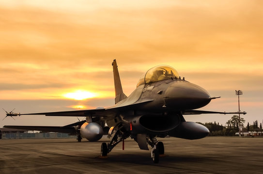 f16 falcon fighter jet on sunset  background