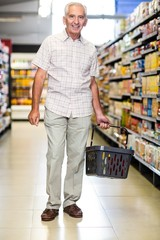 Smiling senior man holding basket
