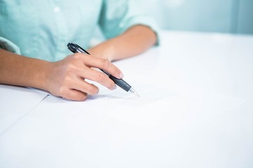 Close up view of a businesswoman writing notes