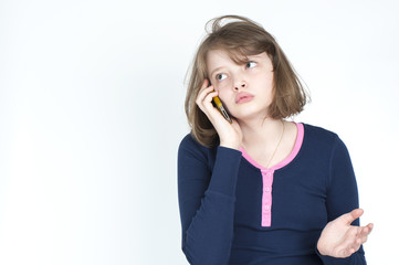 Little girl emotional talking on mobile phone..