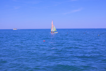 A small sailing yacht.
