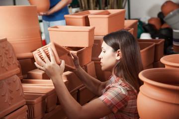 Woman choosing a flower pot