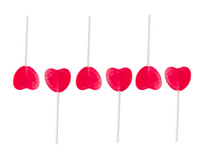 set of lollipops in heart shape. pattern of red candies isolated on white background. a symbol of Valentine's Day