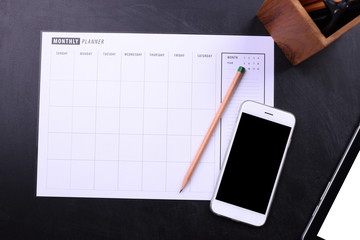 blank screen smartphone and planner schedule