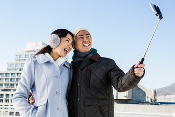Couples taking funny pictures using smartphone