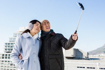 Couple making funny face and clicking pictures