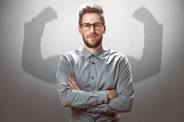 Smiling Businessman with muscular shadow arms